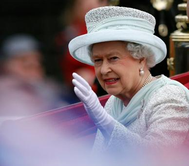 The Queen waves to the crowds after leaving Westminster Hall on the last day of the weekend of celebrations marking the Diamond Jubilee, London, 5 June 2012. © Press Association