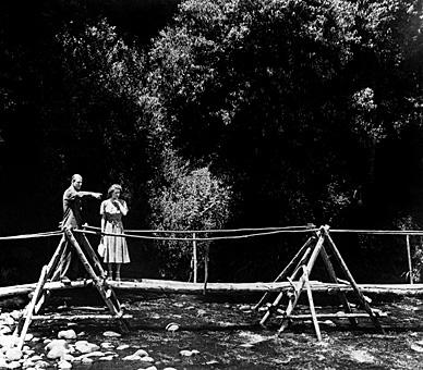 Princess Elizabeth with The Duke of Edinburgh in the grounds of Sagana Lodge in Kenya on the first stage of their Commonwealth tour, 2 February 1952. Four days later, she received the news of her father's death and her own accession to the throne. The tour was abandoned, and the young Princess flew back to Britain as Queen. © Press Association