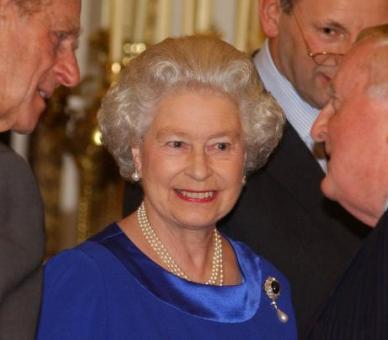 The Queen, with The Duke of Edinburgh, gives a reception for serving and retired Lord-Lieutenants and Lord Provosts at Buckingham Palace, 2002. © Press Association