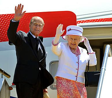 The Queen and The Duke of Edinburgh wave to well wishers from the top of the aircraft steps, at Perth International Airport in western Australia, before boarding their flight home after an eleven-day tour of Australia, 2011. © Press Association